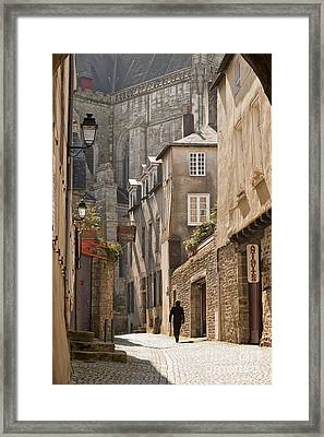 Man Walking Away Down An Ancient Old Medieval Street In Vannes Brittany France Framed Print