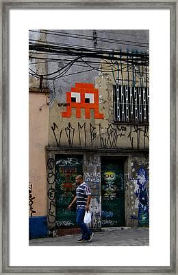 Man Walking On Rua Teodoro Sampaio Framed Print by Julie Niemela