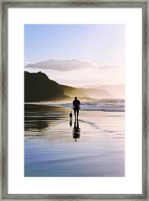Man Walking The Dog On Beach Framed Print by Mikel Martinez de Osaba