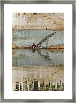 Man Washing Himself / Udaipur, India Framed Print by Adam Jones