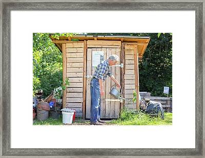 Man Watering Plant Framed Print by Gombert, Sigrid