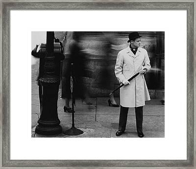 Man Wearing A Raincoat Framed Print by John Rawlings
