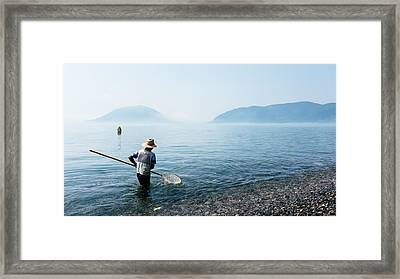 Man With A Net Framed Print