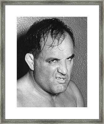 Man With A Sneer Framed Print by Underwood Archives
