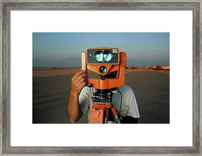 Man With A Survey Instrument In The Libyan Dessert Framed Print by Joe Pasieka/science Photo Library