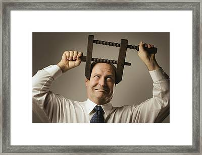 Man With Head In Vice Framed Print