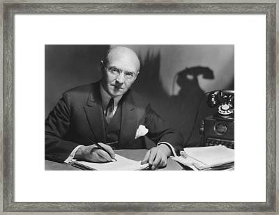 Man Working At His Desk Framed Print by Underwood Archives