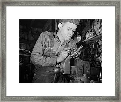 Man Working In A Small Machine Shop Framed Print by Stocktrek Images