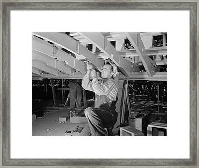 Man Working With A Chisel On A Beam Framed Print