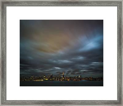 Manhattan On The Horizon Framed Print by Chris Halford