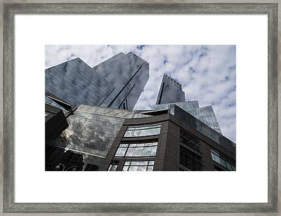 Manhattan Sky And Skyscrapers Framed Print