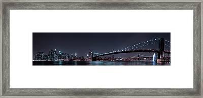 Manhattan Skyline And Brooklyn Bridge Framed Print by Fabien Bravin