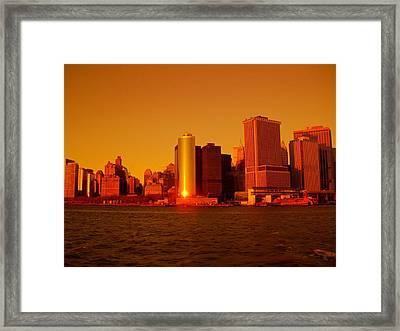 Manhattan Skyline At Sunset Framed Print