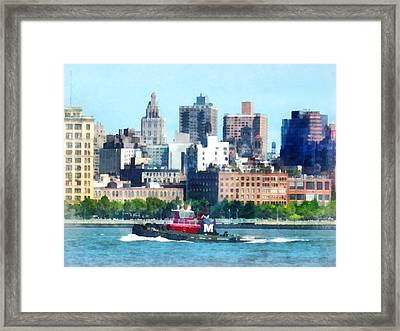 Manhattan - Tugboat Against Manhattan Skyline Framed Print by Susan Savad