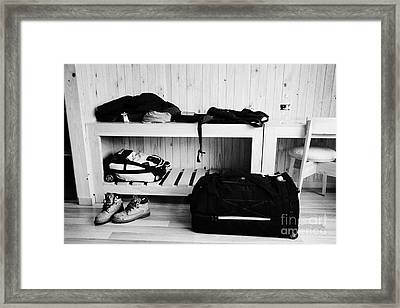 Mans Luggage Piled Up In A Hotel Room Framed Print by Joe Fox