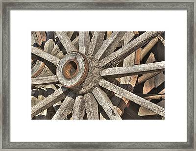 Many Wooden Wheels Framed Print by Phyllis Denton