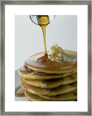 Maple Syrup Being Poured Onto A Stack Of Pancakes Framed Print by Romulo Yanes