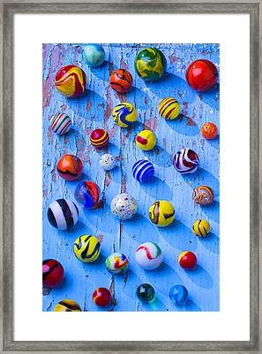 Marbles On Blue Board Framed Print by Garry Gay