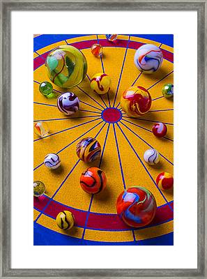 Marbles On Game Board Framed Print by Garry Gay