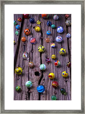 Marbles On Wood Framed Print by Garry Gay
