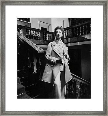 Marella Agnelli Wearing A Courreges Raincoat Framed Print