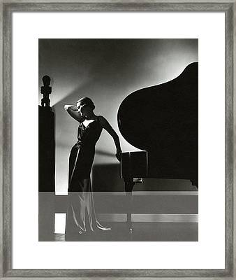 Margaret Horan Posing Beside A Piano Framed Print by Edward Steichen