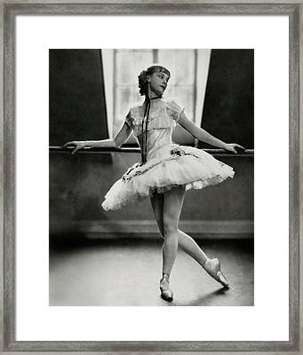 Margaret Petit At The Barre Framed Print by Nickolas Muray