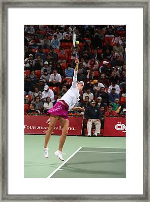 Maria Sharapova Serves In Doha Framed Print by Paul Cowan