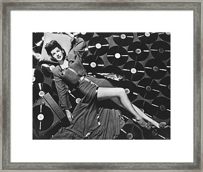Marie Mcdonald With Records Framed Print by Underwood Archives