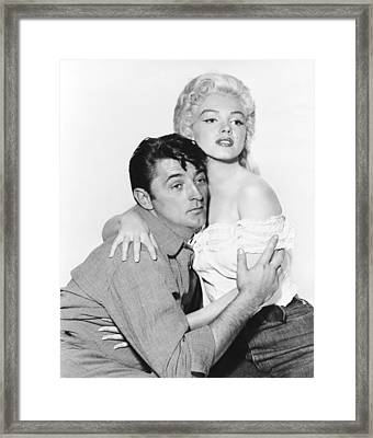 Marilyn Monroe And Robert Mitchum Framed Print by Retro Images Archive