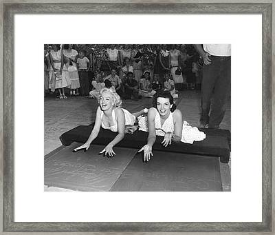Marilyn Monroe And Jane Russell Framed Print by Underwood Archives