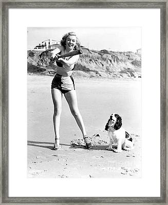Marilyn Playing Baseball At The Beach Framed Print by R Muirhead Art