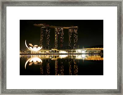 Marina Bay Sands And The Artscience Museum From Across Marina Bay At Night Framed Print by Chris Quek