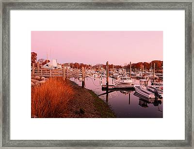 Marina Sunrise Framed Print by Lourry Legarde