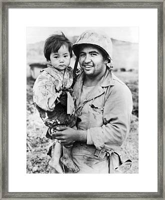 Marine Holds Injured Girl Framed Print by Underwood Archives