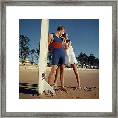 Marisa Berenson And Nat Young On A Beach Framed Print