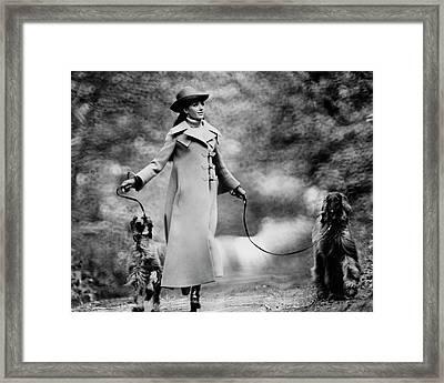 Marisa Berenson Walking Two Dogs Framed Print