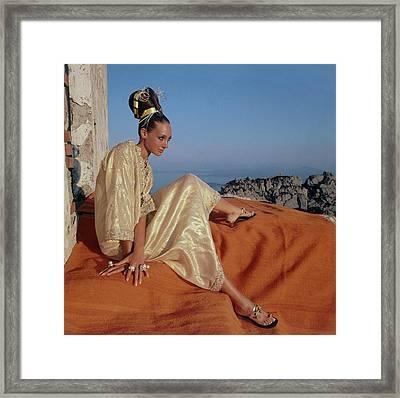 Marisa Berenson Wearing A Gold Caftan By Tina Framed Print