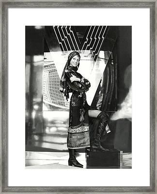 Marisa Berenson Wearing A Paisley Dress And Scarf Framed Print