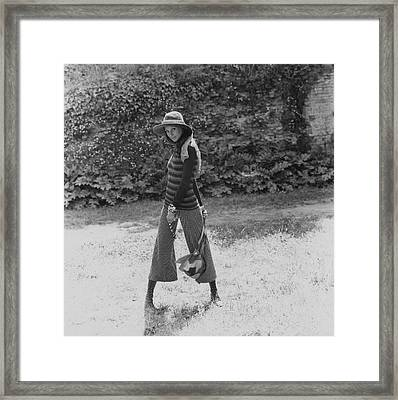 Marisa Berenson Wearing A Sweater And Pants Framed Print by Elisabetta Catalano