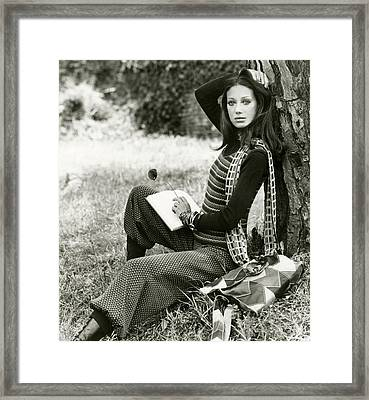 Marisa Berenson Wearing A Sweater Vest And Pants Framed Print by Elisabetta Catalano