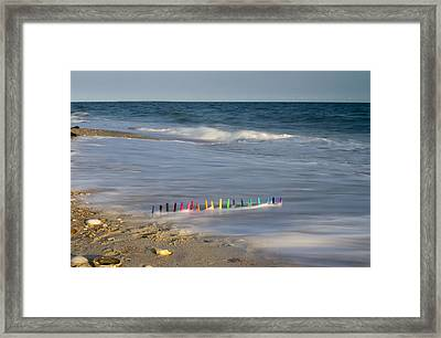Markers In The Surf Framed Print
