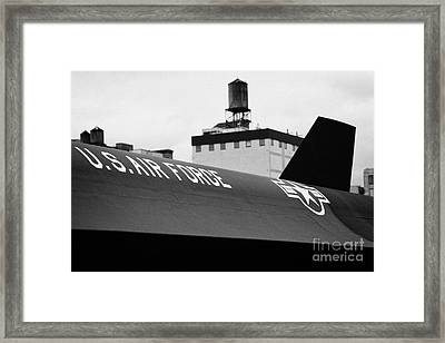 markings on a Lockheed A12 Blackbird on the flight deck of the USS Intrepid  Framed Print