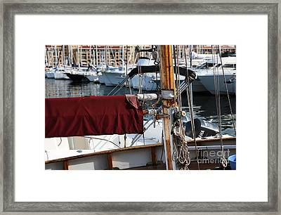 Maroon Sail  Framed Print by John Rizzuto