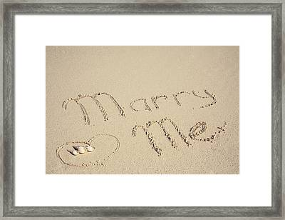 Marry Me Sign On The Sand At The Seaside Framed Print by Maria Feklistova