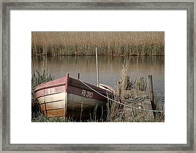 Marsh Boat Framed Print