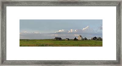 Marsh Houses Framed Print by John Brown