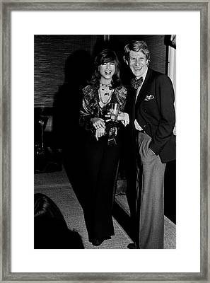 Mary Russell Laughing With Yves St. Laurent Framed Print