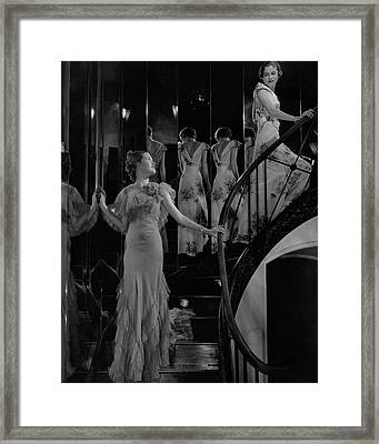 Mary Taylor And Anne Whitehead On A Staircase Framed Print
