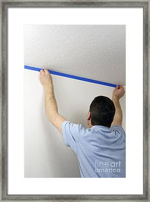Masking A Wall With Blue Tape Framed Print